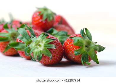 Group of red ripe strawberry with flash filled