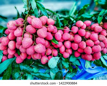 Group Of Red,Juicy Fresh Litchi Fruit In The Market