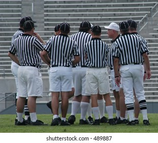 Group of referees conferring