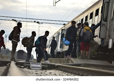 Group of refugees leaving Tovarnik - town on Serbia - Croatia border. They will go into Hungary. October 5,2015; Tovarnik in Croatia