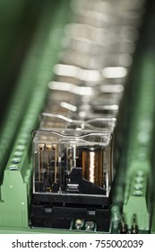 Group of relays in green sockets on DIN 35 rail system