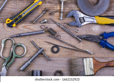 group of repair tools on wooden background