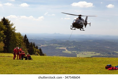 Group of rescuers practice of rescue operation and view of Bohemian landscape on the background, Czech Republic