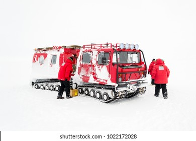A group of researchers with a tracked vehicle in Antarctica