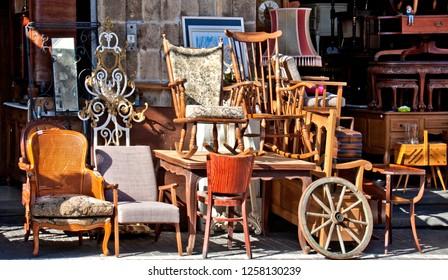 Group of retro home wooden furniture  on Tel Aviv flea market street . Finishing: staining and varnishing. Useful for background.
