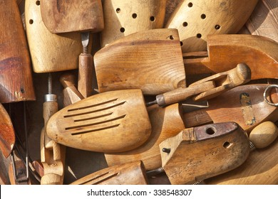 Group of retro style, old wooden shoe pads and strechers on a flea market table. Useful for background.