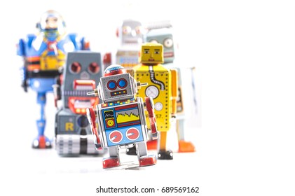 Group of Retro Tin Robots on a white background with copy space