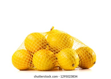 group of ripe lemons in a mesh bag against white background