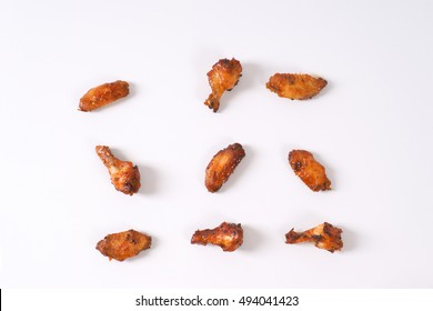 group of roasted chicken wings on white background