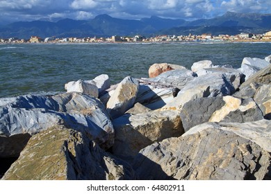 Group of rocks used as a defence against the sea in the port of viareggio