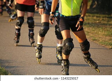 Group of rollerblader (skater) in the evening sun
