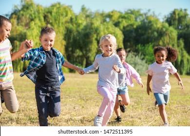 Group of running children in park