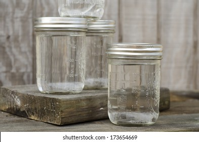Group of Rustic Mason Jars Filled with Moonshine