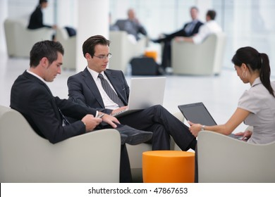 Group of sales people working with laptop computer at a seminar