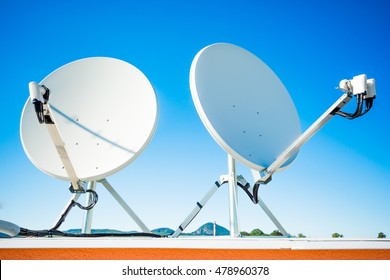 Group of satellite dishes installed with low noise block for receiving three satellites