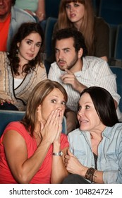 Group of scared men and women in a theater