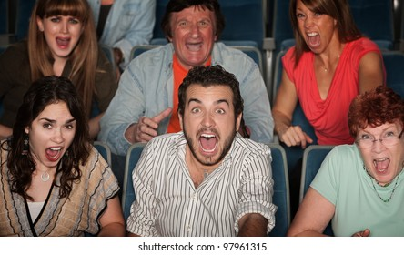 Group of scared people screaming in their seats