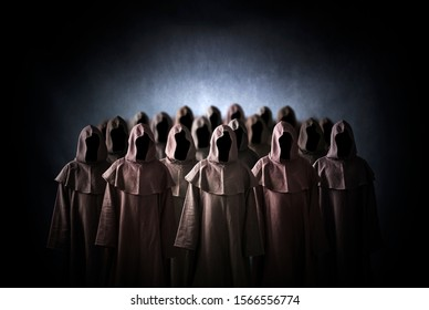 Group of scary figures in hooded cloaks