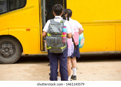 Group of school children boarding the school bus