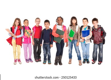 Group of school children posing isolated in white