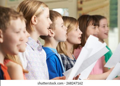 Group Of School Children Singing In School Choir