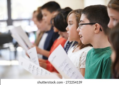 Group Of School Children Singing In Choir Together