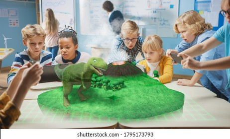 Group of School Children Use Digital Tablet Computers with Augmented Reality App, Looking at Educational 3D Animation - Dinosaur Walking on Island with Active Volcano. VFX, Special Effects Render