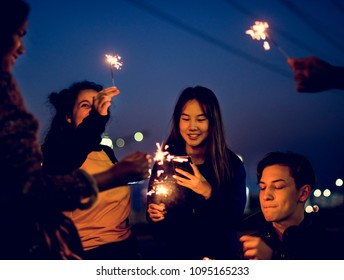 Group of school friends happiness and playing firework