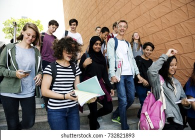 Group of school friends walking down staircase