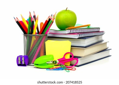 Group of school supplies and books over a white background