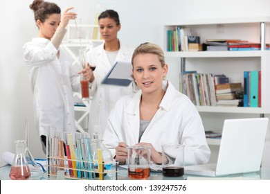 A group of scientists carrying out experiments