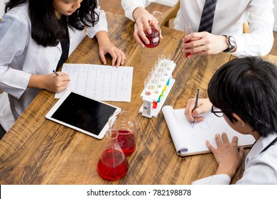Group of scientists and pharmacists in the laboratory.