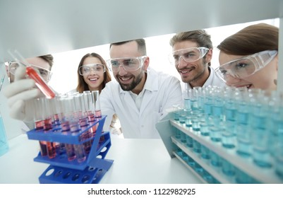 group of scientists and pharmacists working in the laboratory