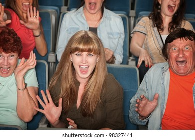 Group of screaming people at the movies