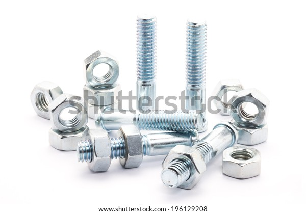 Group of screw-bolts isolated on white. Standing out of the crowd concept.