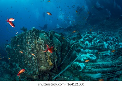 Group of Scuba Divers diving famous, one of the top ten dive sites in the world, where ship Yolanda craned leaving all the material for bathrooms at sea flor that is now home to numerous colorful fish