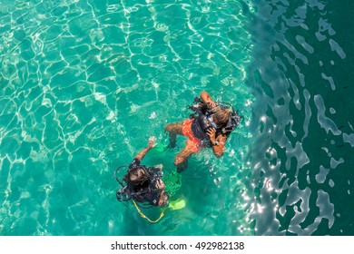 A group of Scuba Diving students have a lesson in shallow crystal clear water of a Tropical Island