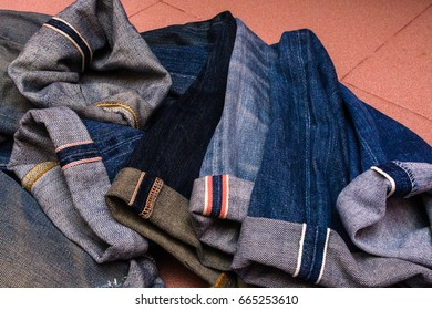a group of selvedge blue jeans pants or denim isolated