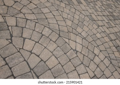 Group of semi circle patterns of pavers for background.
