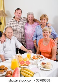 group of senior friends having breakfast together