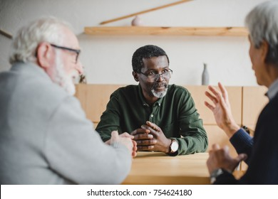 group of senior friends spending time together and sharing stories from past