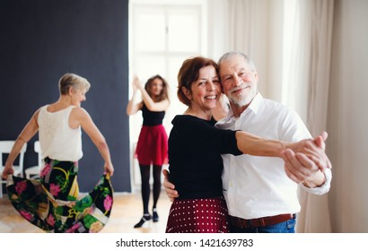 Group of senior people in dancing class with dance teacher.