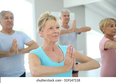 Group of senior people doing fitness exercises in gym