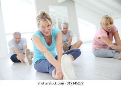 Group of senior people doing stretching exercises