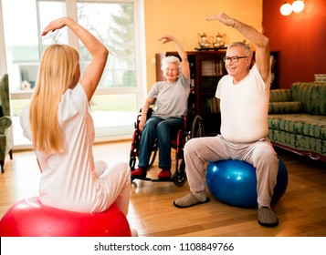 Group of senior people exercise with physiotherapist in private clinic at nursing home