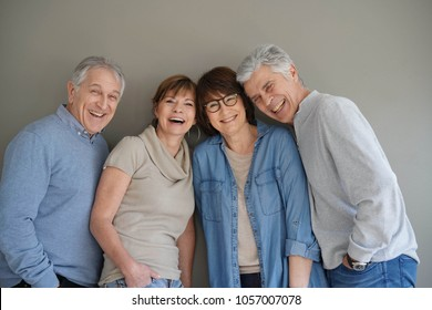 Group of senior people, isolated on grey background