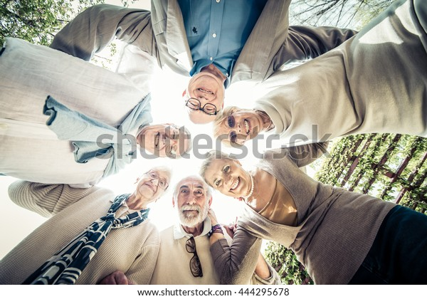 Group of senior people meeting outdoors - Old friends meeting outdoors