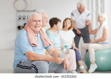 Group of senior people relaxing after workout in a gym