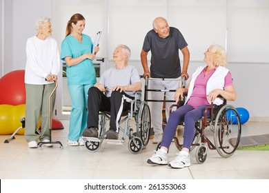 Group of senior people with and without disabilities with geriatric nurse at physiotherapy