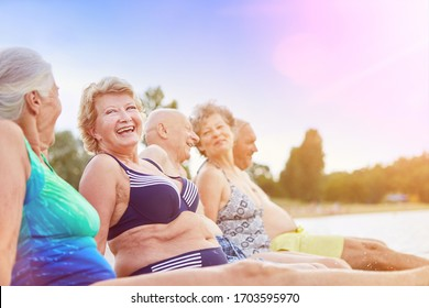 Group of seniors bathing at the lake in summer
